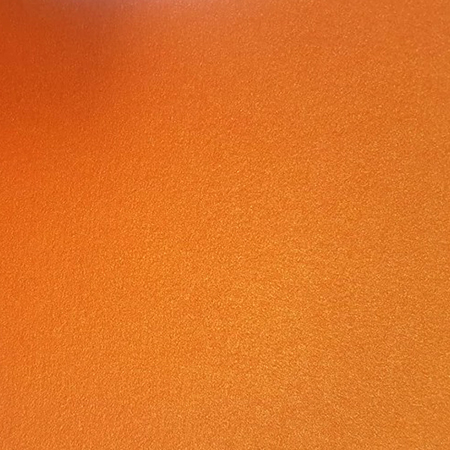 Close up of orange metallic card