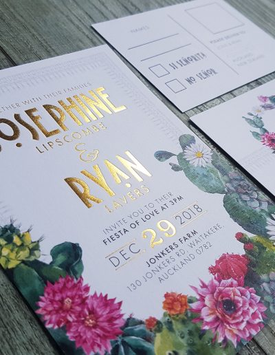 Gold foil stamped invitations with colourful floral design