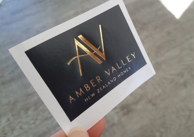 Gold and black product labels for Amber Valley