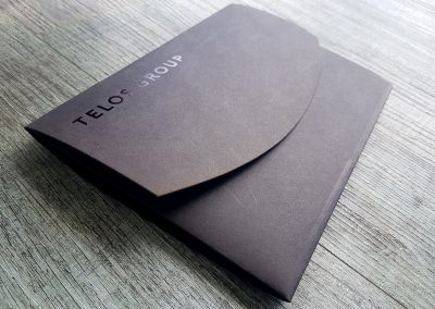 Custom branded pocketfold envelopes printed for Hibiscus Coast real estate firm, Telos Group