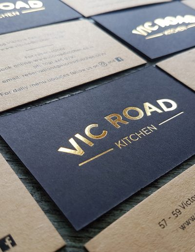 Black and kraft sandwiched cards with gold foil logo pressed - card design and printing by Pinc