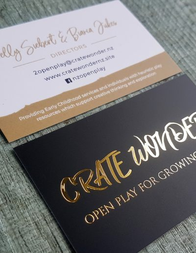 Gold foil logo onto white card with printed black and matt laminate coating, designed by Pinc