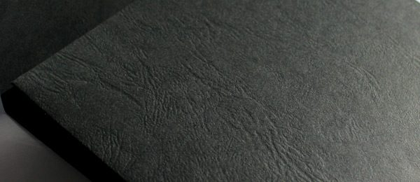 Black leather embossed card close up