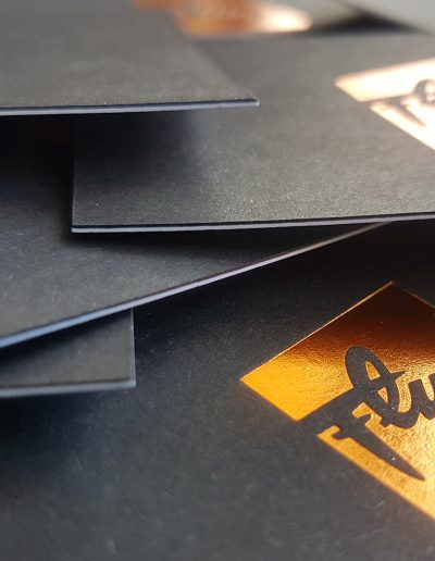 Black and white layered business cards, black with copper foil and white with digital print