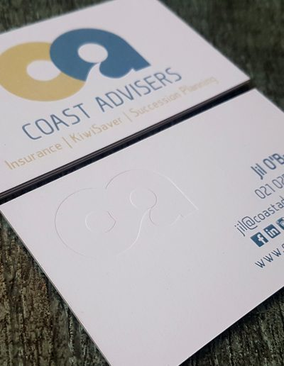 Debossed logo on a thick white card