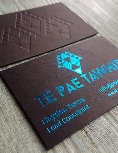 Blue foil stamp and embossed pattern on ultra thick black card on these NZ business cards