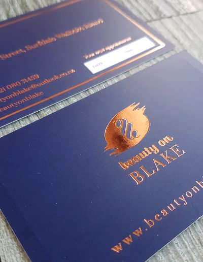 Rose gold foil stamp on printed navy blue with matt laminate coating