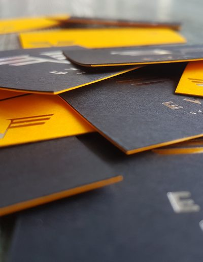 Thick black and orange business cards with silver foil both sides