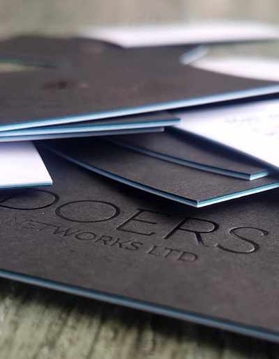 3 layer coloured business cards - gloss black foil logo on black card, blue in between, and white card with digital print