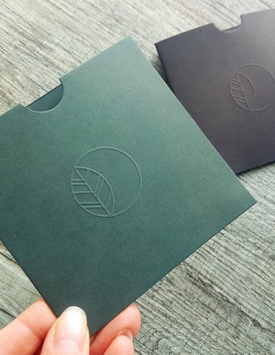 Embossed gift voucher sleeves with Beauty of Arcadia logo