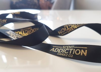 Gold on black printed ribbon for business branding