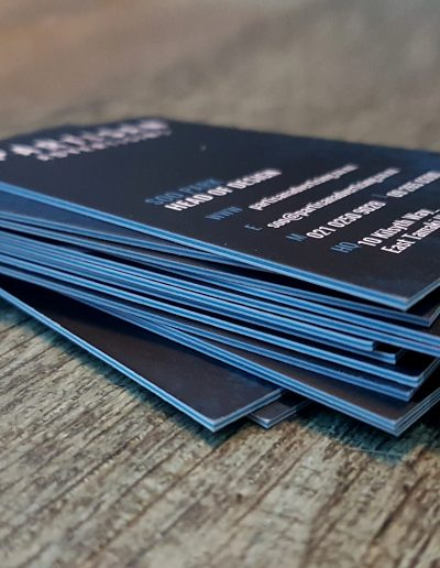 Bright blue sandwiched business cards with double sided digital print and matt laminate coating