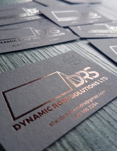 Bronze foil stamp on charcoal card, premium business cards for NZ roofer