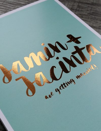Bronze foil names printed on a mint green background