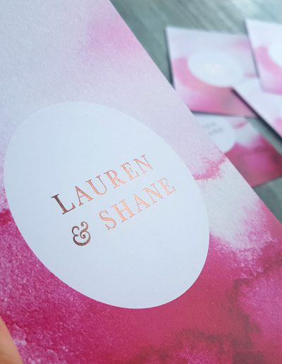 Pink and bronze wedding invitations