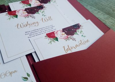 Close up of info cards in one of Pinc's maroon pocketfold envelopes