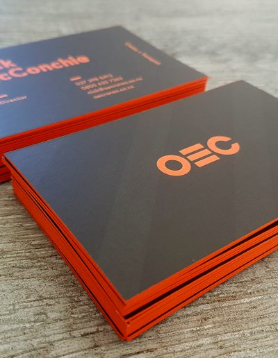 Orange coloured edges on these black printed business cards