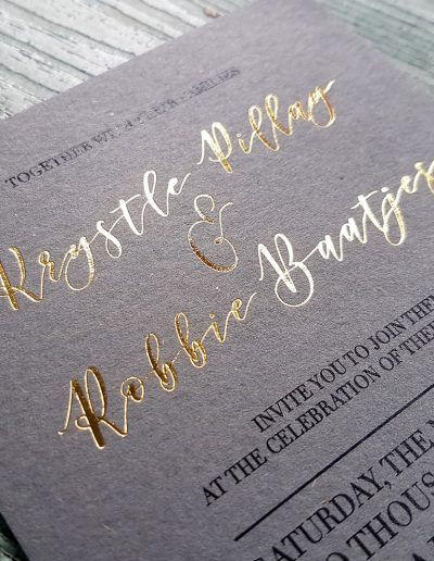 Gold foil on a thick charcoal card stock, designed and printed by Pinc