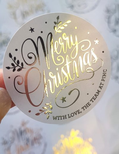Christmas stickers, gold on white paper grade