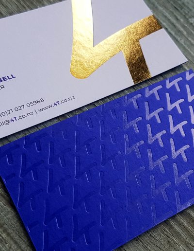 Bonded business cards - white with digital print + gold foil, and purple with clear foil + gold foil logo