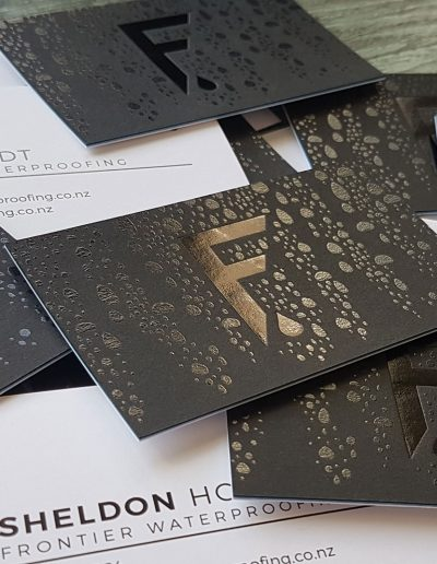 Clear toner printed droplets with gloss black foil F pressed into ultra thick cards