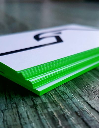 Lime green coloured edges on business cards