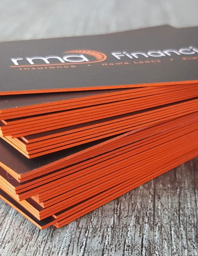 Bold orange edges on the sides of RMA Financial's business cards