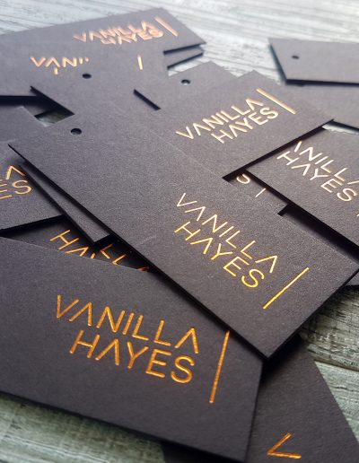 Copper swing tags on ultra thick black card for graphic design team, Vanilla Hayes