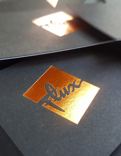 Copper foil stamp on ultra thick business cards, giving a tactile logo finish