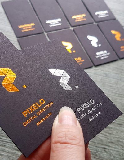 Copper, silver, debossed business cards onto thick black card