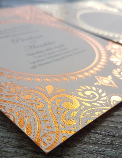 Copper foil stamped pattern onto a textured ivory card stock