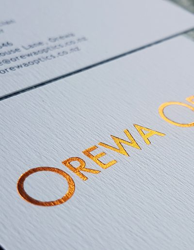Copper foil on textured white for local Hibiscus Coat business, Orewa Optics