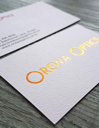 Textured white card with copper foil logo