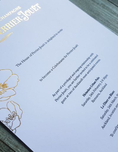 Corporate event invitation printing - gold foil on white card