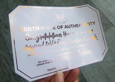 Custom Certificate of Authenticity in blush foil, designed and printed by Pinc