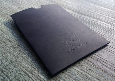 Custom branded sleeves - embossed design on matt black card