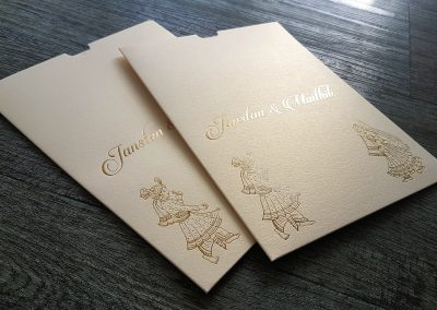 Customised sleeves, gold foil stamped onto ivory metallic