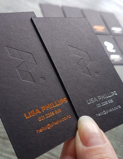 Blind debossed business cards pressed into ultra thick black card