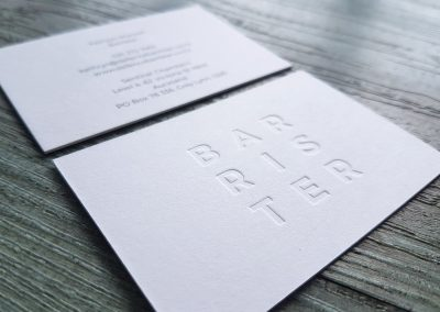 Debossed logo into an ultra thick, pulpy white card stock
