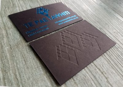 Debossed pattern pressed into ultra thick black card with blue foil