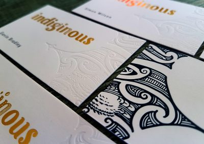 Debossed pattern pressed into thick white business cards for gin business, Indiginous