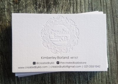 Debossed logo onto textured business cards