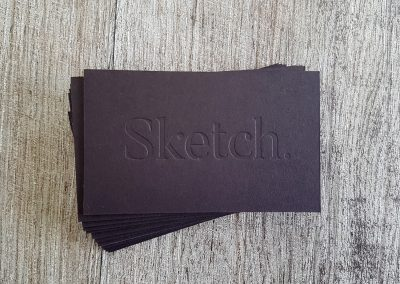 Debossed logo for Sketch Studio's business cards pressed into an ultra thick black card