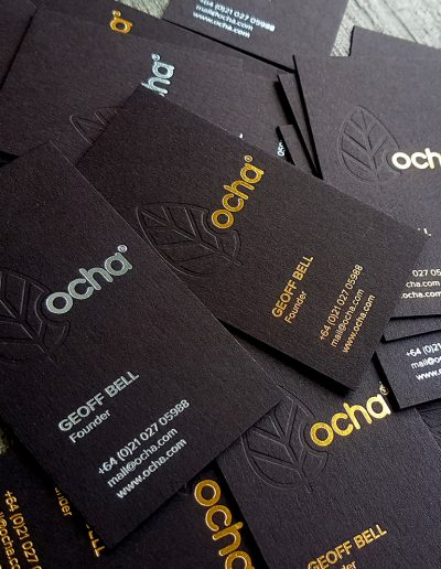 Debossed leaf logo + gold and light blue foil contact details