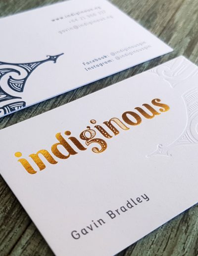 Premium thick business cards with gold foil stamped logo and indented pattern