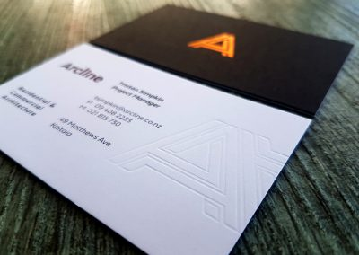 Debossed logo pressed into ultra thick black and white layered business cards