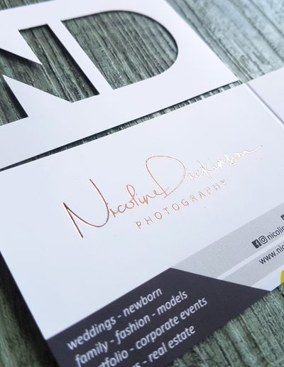 Die cut business cards with rose gold foil, designed and printed by PInc