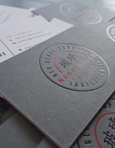 Duplexed business cards using charcoal card stamped with 2 foil colours + a textured linen stock