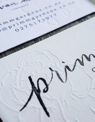 Embossed business cards by Auckland printing studio