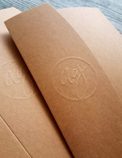 Kraft pocketfolds with embossed logo